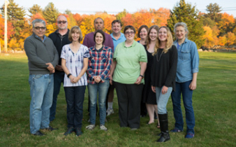 Certified peer specialists in Advocates Peer Support Team posing outside